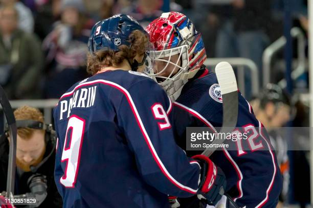 Columbus Blue Jackets left wing Artemi Panarin and Columbus Blue Jackets goaltender Sergei Bobrovsky celebrate after winning a game between the...