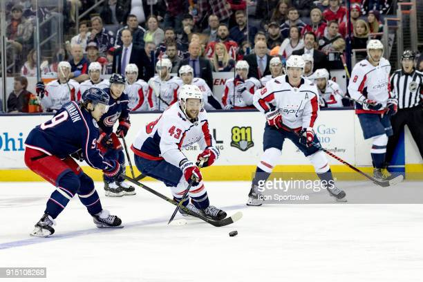 Columbus Blue Jackets left wing Artemi Panarin and Washington Capitals right wing Tom Wilson battle for the puck in the second period of a game...