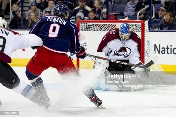 Columbus Blue Jackets left wing Artemi Panarin attempts a shot on goal as Colorado Avalanche goaltender Semyon Varlamov blocks in the third period of...