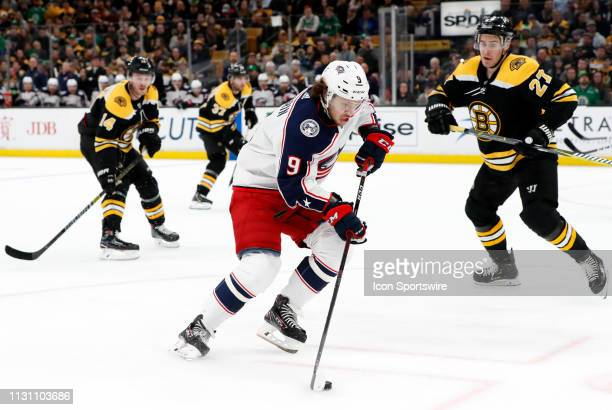 Columbus Blue Jackets left wing Artemi Panarin gets past Boston Bruins defenseman John Moore during a game between the Boston Bruins and the Columbus...