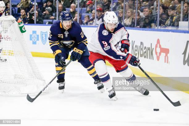 Columbus Blue Jackets Left Wing Artemi Panarin skates with the puck as Buffalo Sabres Winger Sam Reinhart defends during the Columbus Blue Jackets...