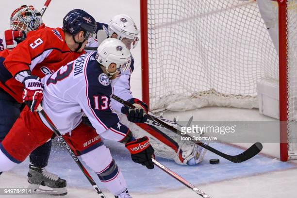 Columbus Blue Jackets left wing Matt Calvert scores in the second period against Washington Capitals goaltender Braden Holtby on April 21 at the...