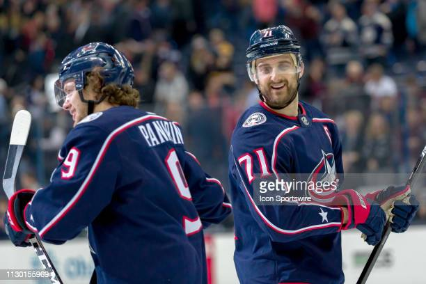 Columbus Blue Jackets left wing Nick Foligno and Columbus Blue Jackets left wing Artemi Panarin smile after winning a game between the Columbus Blue...