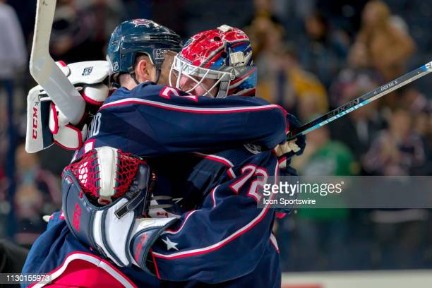 Columbus Blue Jackets left wing Nick Foligno and Columbus Blue Jackets goaltender Sergei Bobrovsky hug after winning a game between the Columbus Blue...
