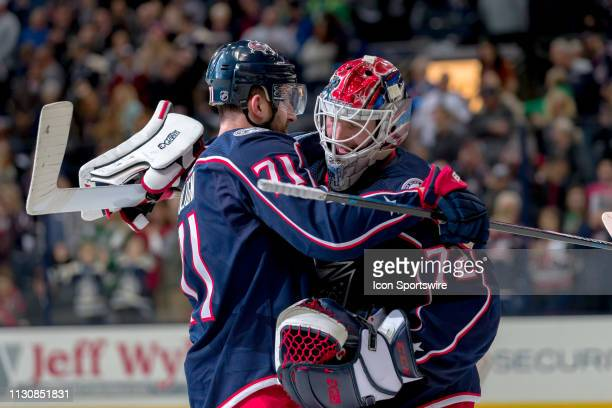 Columbus Blue Jackets left wing Nick Foligno and Columbus Blue Jackets goaltender Sergei Bobrovsky celebrate with a hug after winning a game between...