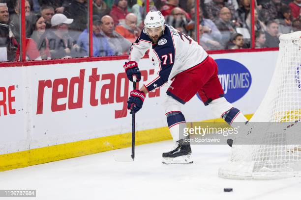 Columbus Blue Jackets left wing Nick Foligno backhands the puck out from behind the net during first period National Hockey League action between the...