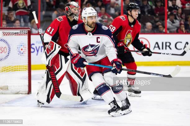 Columbus Blue Jackets left wing Nick Foligno skates around Ottawa Senators goaltender Craig Anderson during third period National Hockey League...