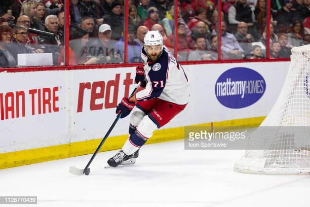 Columbus Blue Jackets left wing Nick Foligno skates the puck around the net during first period National Hockey League action between the Columbus...