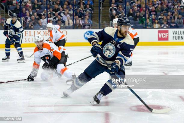 Columbus Blue Jackets left wing Nick Foligno steals the puck from Philadelphia Flyers defenseman Shayne Gostisbehere in the third period of a game...