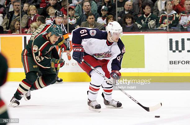 Columbus Blue Jackets left wing Rick Nash chased by Minnesota Wild right wing Branko Radivojevic during the Minnesota Wild's overtime defeat of the...