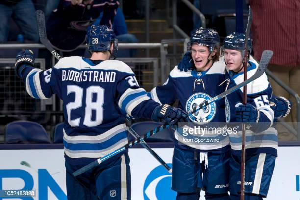 Columbus Blue Jackets left wing Sonny Milano celebrates with teammates after scoring a goal in the third period of a game between the Columbus Blue...