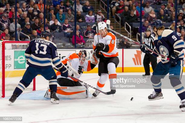 Columbus Blue Jackets right wing Cam Atkinson and Philadelphia Flyers defenseman Robert Hagg battle for the puck as Philadelphia Flyers goaltender...