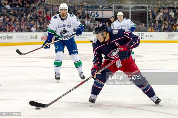 Columbus Blue Jackets right wing Cam Atkinson controls the puck in a game between the Columbus Blue Jackets and the Vancouver Canucks on December 11...