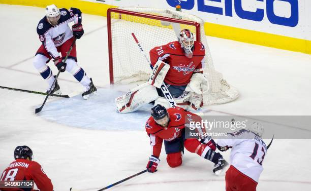 Columbus Blue Jackets right wing Cam Atkinson shoots on Washington Capitals goaltender Braden Holtby during the first round Stanley Cup playoff game...