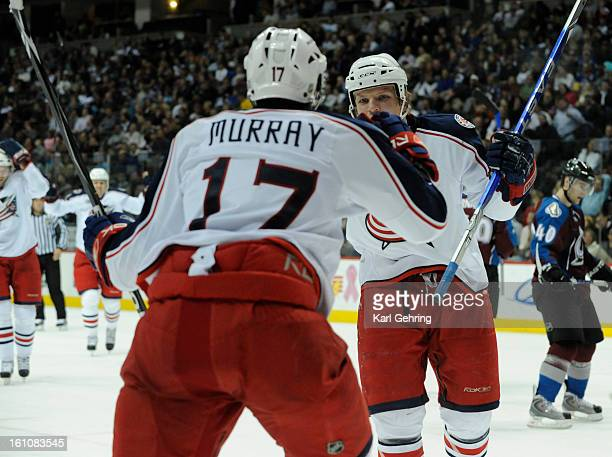 SP30AVALANCHE Columbus Blue Jackets right wing Derek Dorsett celebrates with center Andrew Murray after Murray scored in the second period The...