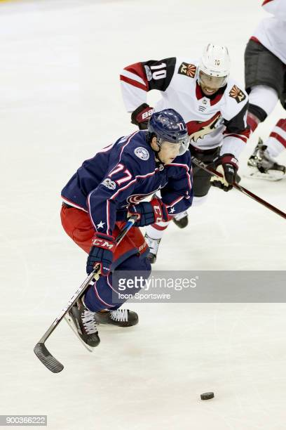 Columbus Blue Jackets right wing Josh Anderson and Arizona Coyotes left wing Anthony Duclair battle for control of the puck during the first period...