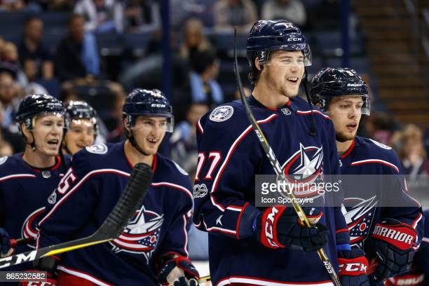 Columbus Blue Jackets right wing Josh Anderson and teammates smile as they wait for a shot on goal during warmups before a game between the Columbus...