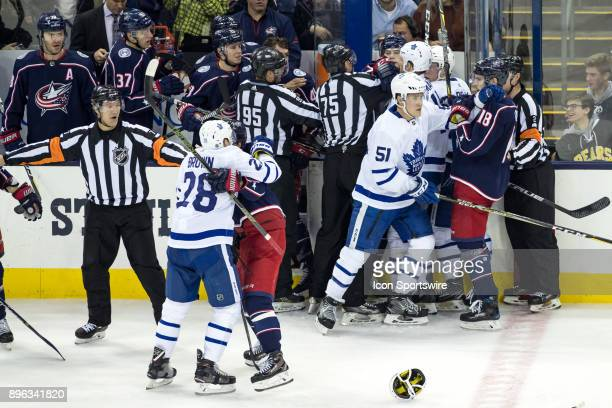 Columbus Blue Jackets right wing Josh Anderson and Toronto Maple Leafs left wing Matt Martin fight and teammate join in during the third period in a...