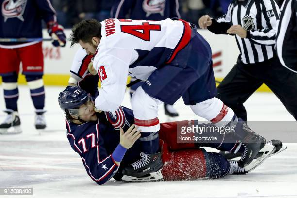 Columbus Blue Jackets right wing Josh Anderson and Washington Capitals right wing Tom Wilson fight in the first period of a game between the Columbus...