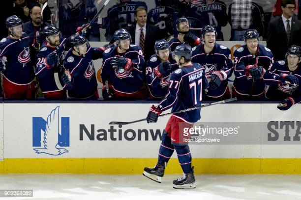Columbus Blue Jackets right wing Josh Anderson celebrates with teammates after scoring the go ahead goal during a shootut in a game between the...