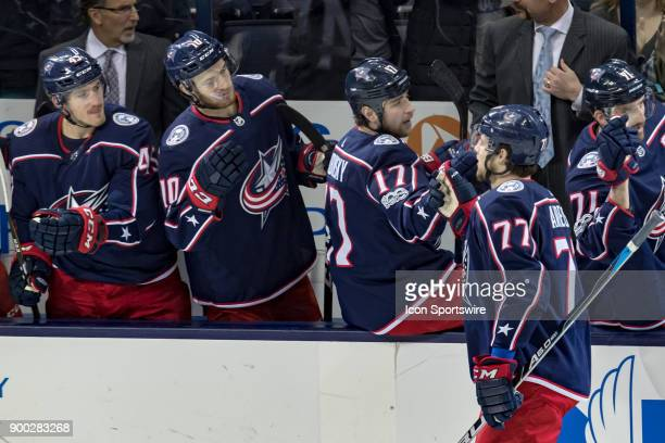 Columbus Blue Jackets right wing Josh Anderson celebrates with teammates on the bench after scoring a goal during a game between the Columbus Blue...