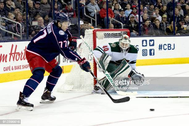Columbus Blue Jackets right wing Josh Anderson passes the puck as Minnesota Wild goaltender Devan Dubnyk defends the goal in the first period of a...
