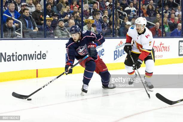 Columbus Blue Jackets right wing Josh Anderson passes the puck in the third period of a game between the Columbus Blue Jackets and the Calgary Flames...