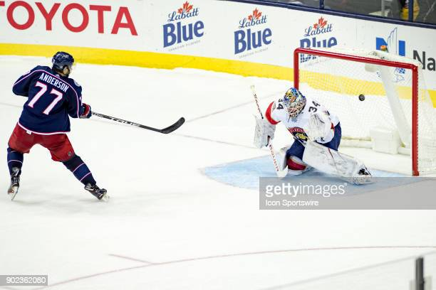 Columbus Blue Jackets right wing Josh Anderson scores the final goal of a shotout as Florida Panthers goaltender James Reimer misses a block in a...