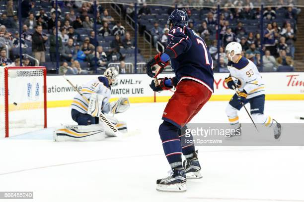Columbus Blue Jackets right wing Josh Anderson shoots and scores while Buffalo Sabres goalie Chad Johnson looks the other way during the third period...