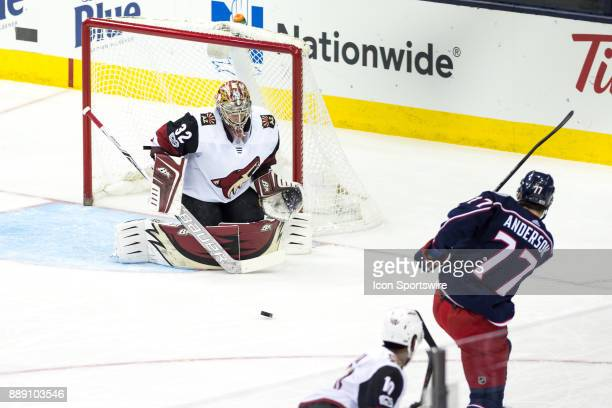 Columbus Blue Jackets right wing Josh Anderson takes a shot on goal while Arizona Coyotes goalie Antti Raanta defends during the first period in a...