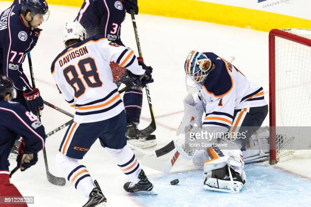Columbus Blue Jackets right wing Josh Anderson takes a shot on goal as Edmonton Oilers goalie Laurent Brossoit blocks during the first period in a...