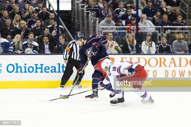 Columbus Blue Jackets right wing Josh Anderson takes a shot on goal while New York Rangers defenseman Marc Staal reaches in with his stick to defend...