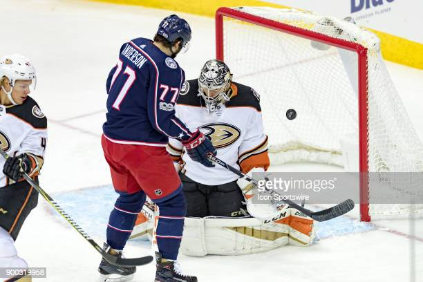 Columbus Blue Jackets right wing Josh Anderson watches as the puck flies past Anaheim Ducks goalie John Gibson during the first period in a game...