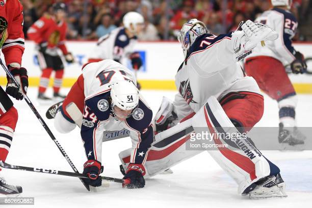 Columbus Blue Jackets right wing Miles Koules trips after colliding with Columbus Blue Jackets goalie Joonas Korpisalo in the first period during a...