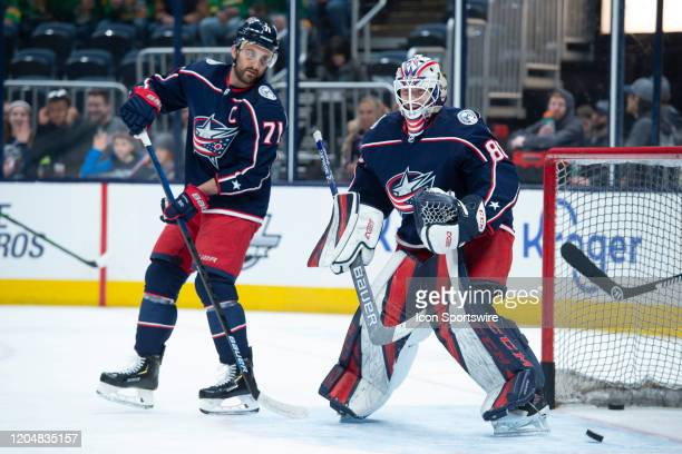 Columbus Blue Jackets Winger Nick Foligno and Columbus Blue Jackets Goalie Matiss Kivlenieks warm up during an NHL game between the Columbus Blue...