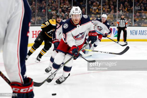 Columbus Blue Jackets winger Riley Nash picks up the puck during Game 2 of the Second Round 2019 Stanley Cup Playoffs between the Boston Bruins and...