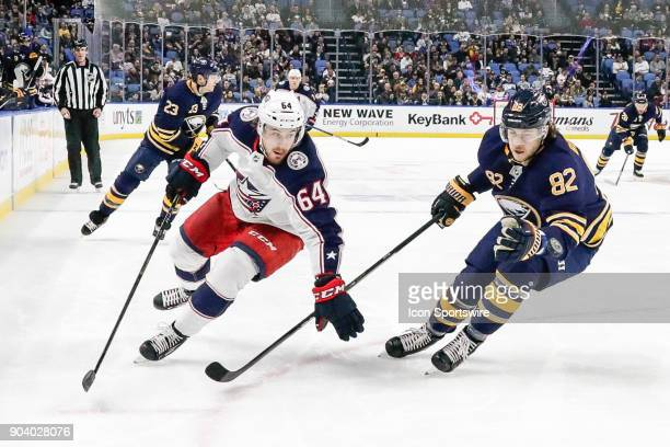 Columbus Blue Jackets Winger Tyler Motte skates with the puck as Buffalo Sabres Defenseman Nathan Beaulieu defends during the Columbus Blue Jackets...