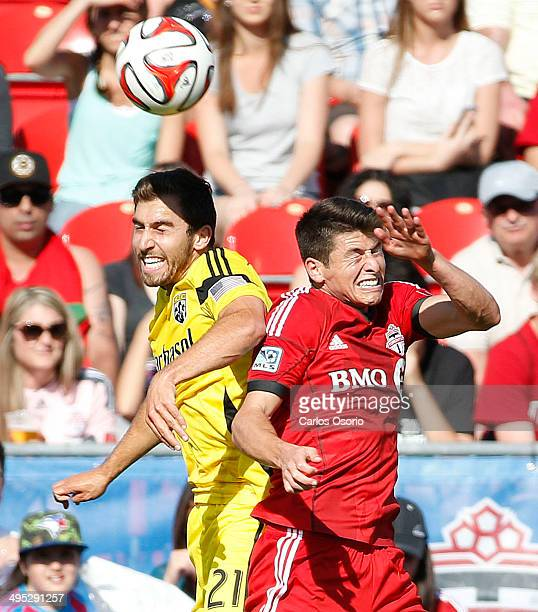 TORONTO ON MAY 31 Columbus' Chad Barson jumps for a ball against TFC's Mark Bloom during the 1st half of MLS action as the Toronto FC take on the...