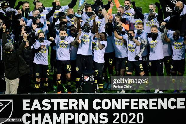 Columbus Crew captain Jonathan Mensah holds up the Eastern Conference trophy after their 1-0 win over the New England Revolution during the Eastern...