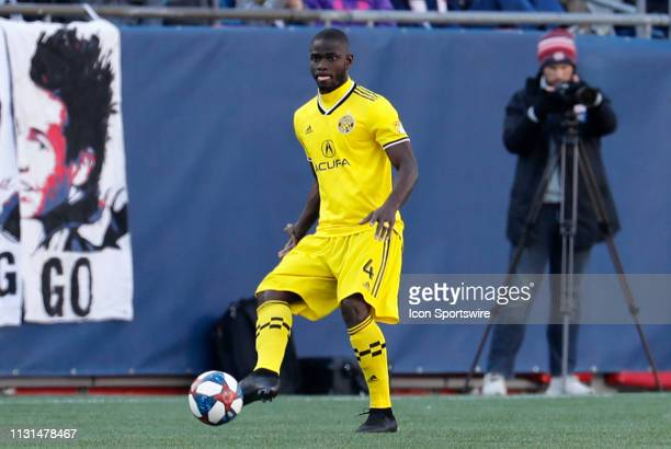 Columbus Crew defender Jonathan Mensah plays the ball during a match between the New England Revolution and Columbus Crew SC on March 9 at Gillette...