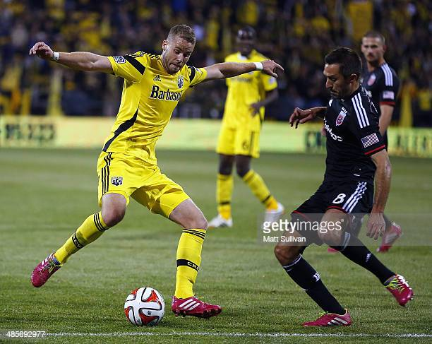 Columbus Crew defender Josh Williams fights for the ball with DC United midfielder Davy Arnaud during the second half of their game at Columbus Crew...
