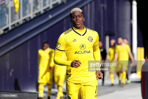 Columbus Crew forward Gyasi Zardes leads the Crew onto the pitch for the second half during a match between the New England Revolution and Columbus...