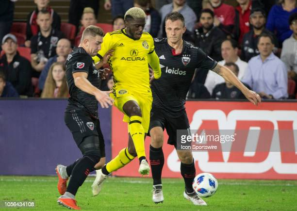 Columbus Crew forward Gyasi Zerdes caught between DC United midfielder Russell Canouse and defender Frederic Brillant during an MLS Playoffs Knockout...