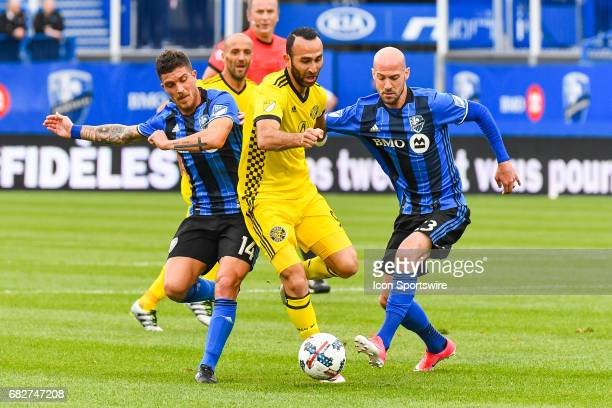 Columbus Crew forward Justin Meram battling for control of the ball with Montreal Impact defender Laurent Ciman and Montreal Impact midfielder Adrian...