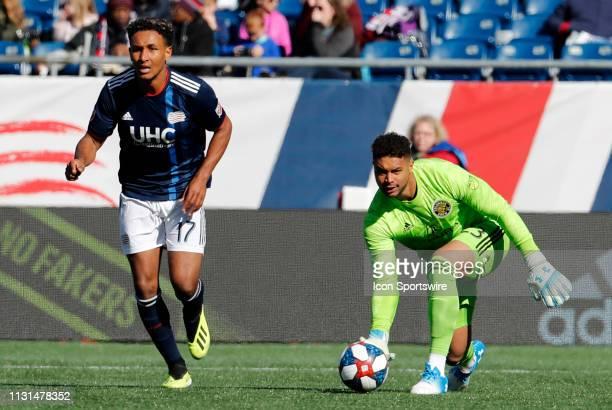 Columbus Crew goalkeeper Zack Steffen distributes the ball away from New England Revolution forward Juan Agudelo during a match between the New...