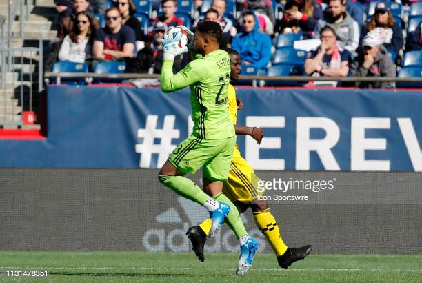 Columbus Crew goalkeeper Zack Steffen hauls in a cross during a match between the New England Revolution and Columbus Crew SC on March 9 at Gillette...