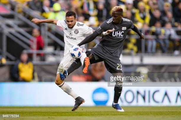 Columbus Crew midfielder Artur and New England Revolution midfielder Wilfried Zahibo battle for possession in the MLS regular season game between the...