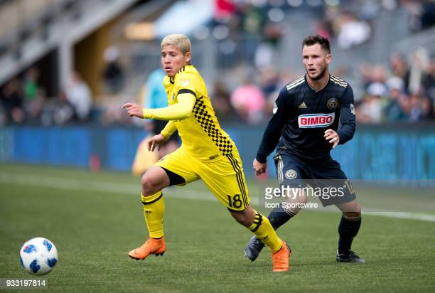 Columbus Crew Midfielder Cristian Martinez pushes the ball away from Union Defender Keegan Rosenberry in the first half during the game between the...