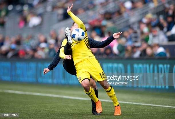 Columbus Crew Midfielder Cristian Martinez takes a boot in the chin from Union Defender Keegan Rosenberry in the first half during the game between...
