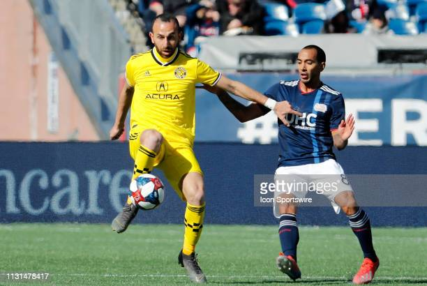 Columbus Crew midfielder Justin Meram controls the ball with New England Revolution defender Edgar Castillo moving in during a match between the New...